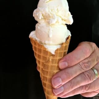 Easy No-Cook Meyer Lemon Ice Cream in an ice cream cone