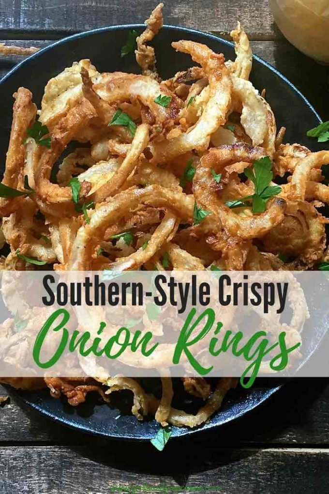 Thinly sliced and more like onion straws or onion strings, easy, homemade Southern Style Crispy Onion Rings are delectable cruciferous vegetables bathed in buttermilk, coated with a light dusting of flour and quickly fried, which makes them extra crispy, and extremely flavorful! Try this recipe today! #sidedish, #dinner, #vegetarianrecipes, #easyrecipe, #comfortfood,