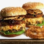 The Ultimate Southern Style Burger with onions rings, melted pimento cheese and fried green tomato