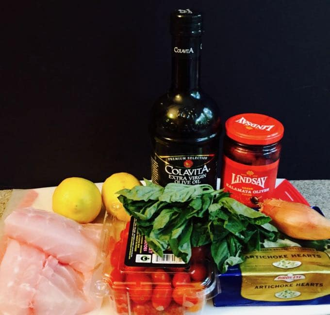Fish fillets, lemons, cherry tomatoes, kalamata olives, basil and olive oil