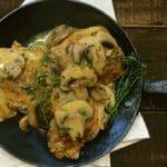 Skillet Chicken with Mushroom Sauce in handmade cast iron skillet