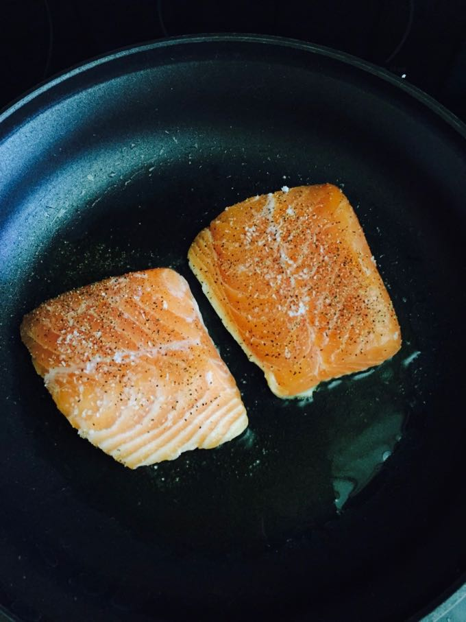 Easy Pan Seared Salmon with Asparagus pan searing the fillets