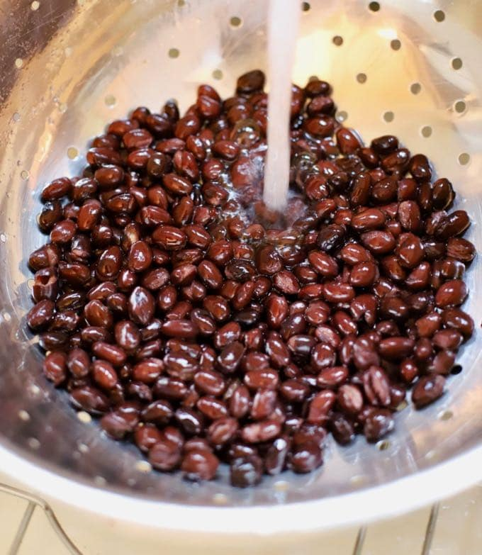 Rinsing black beans for Best Ever Easy Southern Caviar Dip