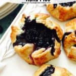 Pinterest pin for Blueberry Hand Pies showing them on a white serving plate.