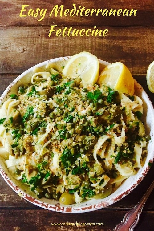 One bite of Easy Mediterranean Fettuccine's bright, flavorful heart-healthy pasta, full of green olives, capers, and fresh herbs and you will be in heaven!This simple recipe is comfort food at it's finest and the perfect weeknight dinner. #comfortfood, #dinner, #dinnerrecipes, #easydinner, #pasta, #fettuccine, #vegetarian