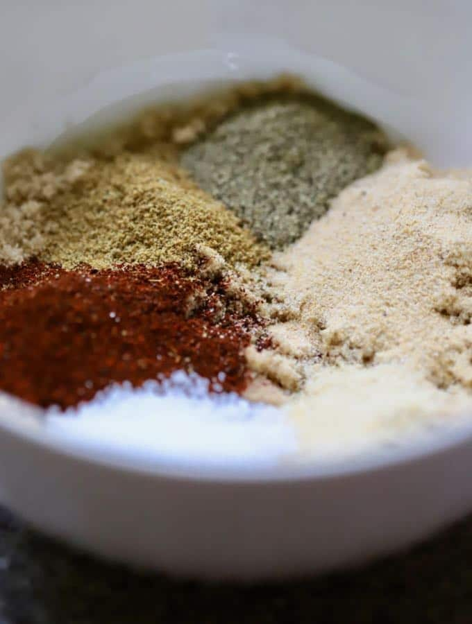 A bowl of dry rub ingredients for the Best Oven Baked Baby Back Ribs