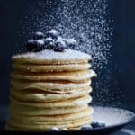 Adding confectioners sugar to Easy Buttermilk Blueberry Pancakes