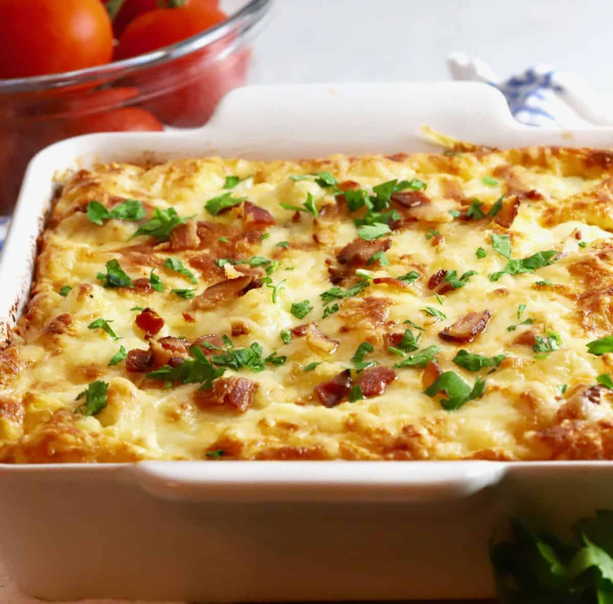 Cauliflower Cheese Bake in a white baking dish.