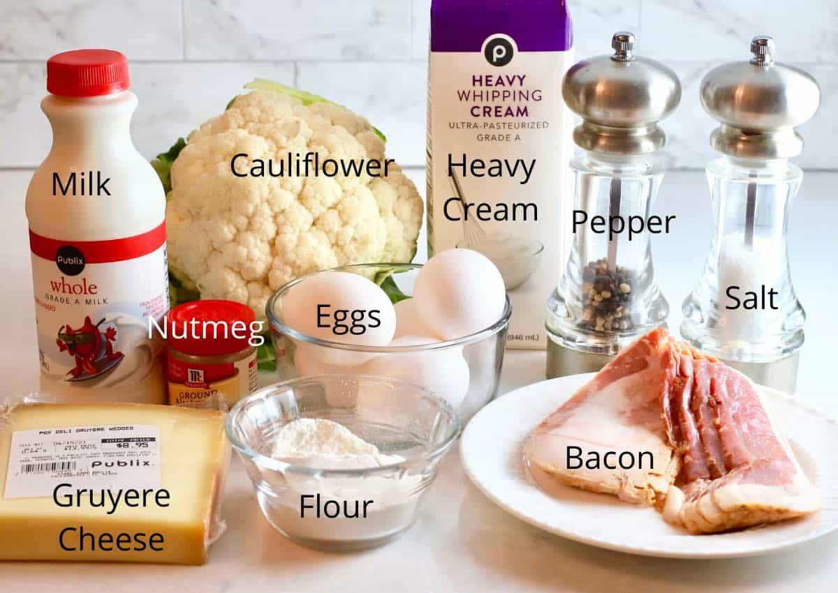 A head of cauliflower, milk, heavy cream, bacon and cheese.