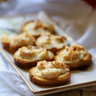 Right out of the oven Cheesy Creole Shrimp Toast on a plate ready to serve