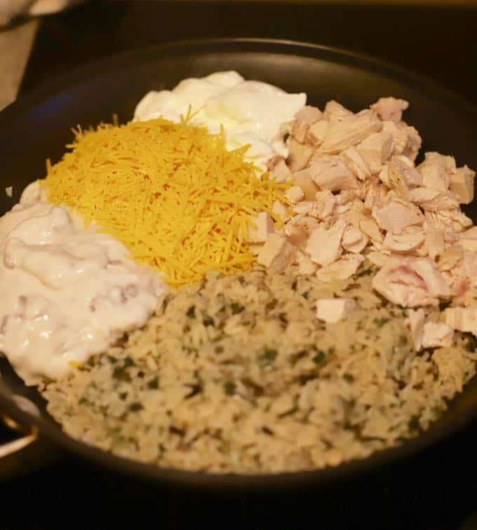 Mixing in chicken and rice for Easy Chicken and Wild Rice Casserole