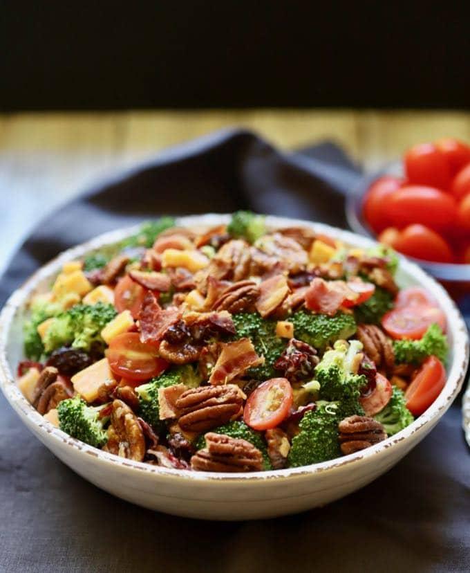 A big bowl of Broccoli Salad full of fresh broccoli, pecans and cranberries.