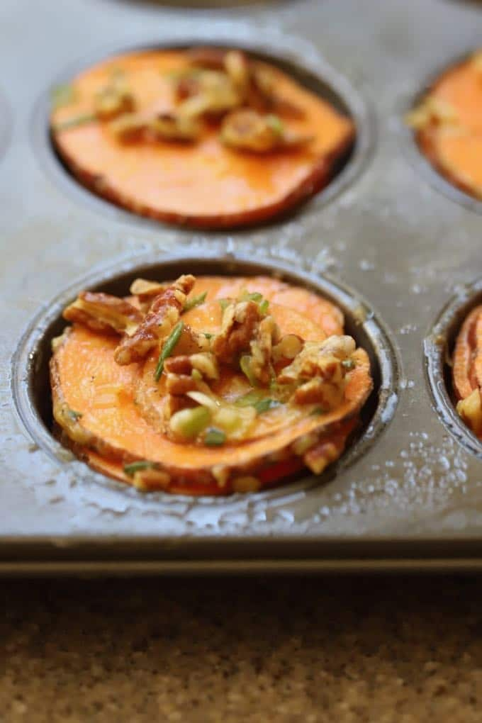 Healthy Roasted Sweet Potato Stacks in a muffin pan and ready to bake