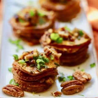 Healthy Roasted Sweet Potato Stacks topped with toasted pecans, scallions, and rosemary