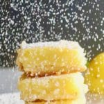Confectioner's sugar being sifted on Luscious Southern Meyer Lemon Bars