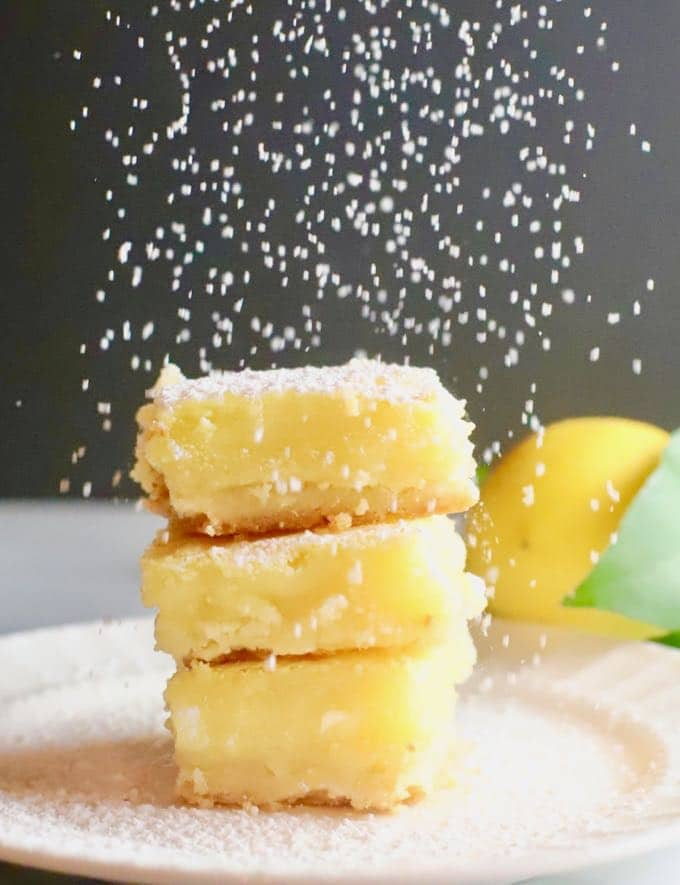 Luscious Southern Meyer Lemon Bars being covered with confectioner's sugar