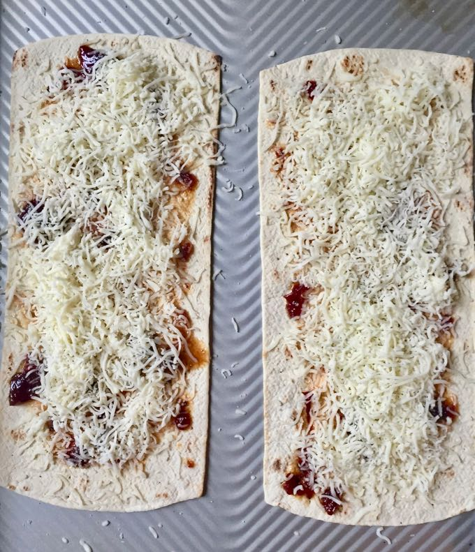 Flatbread covered with sauce and cheese for Quick and Healthy Italian Salad Pizza