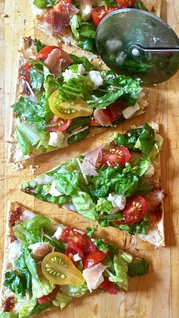 Cutting slices of Quick and Healthy Italian Salad Pizza