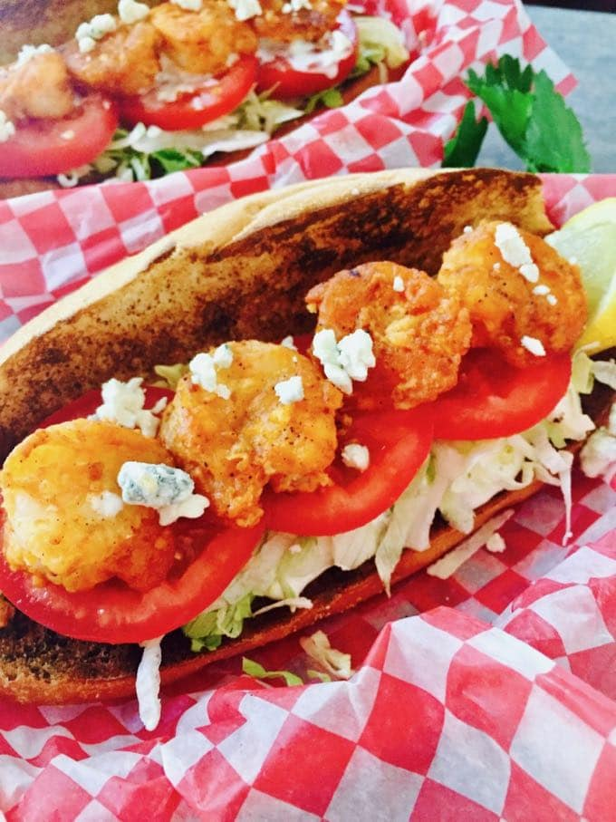 Spicy Shrimp Po' Boy Sandwiches topped with blue cheese crumbles