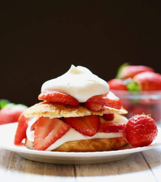 A serving of Classic Southern Strawberry Shortcake piled high with whipped chream