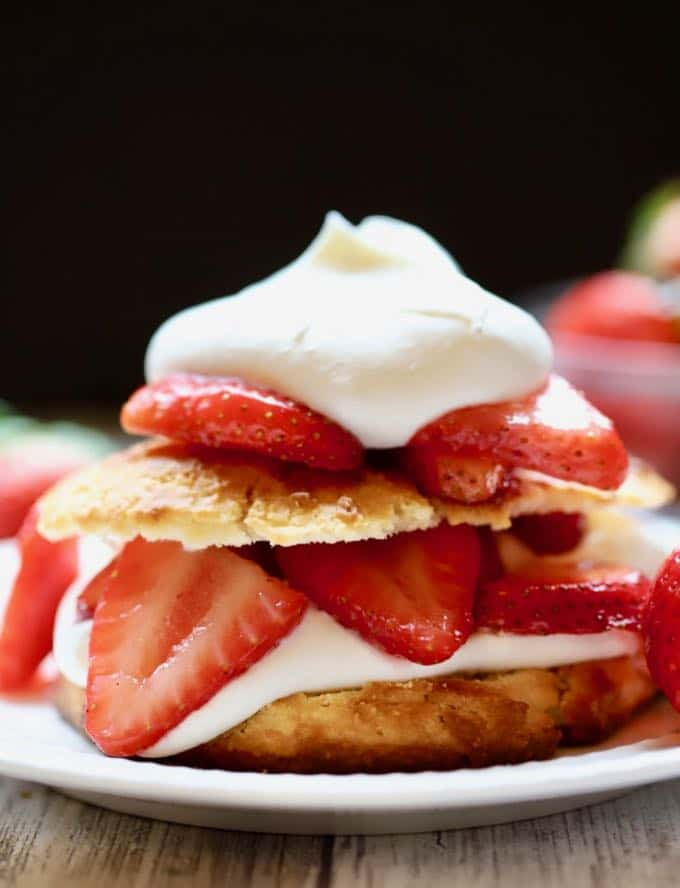 Close up photo of Classic Southern Strawberry Shortcake topped with a dollop of whipped cream