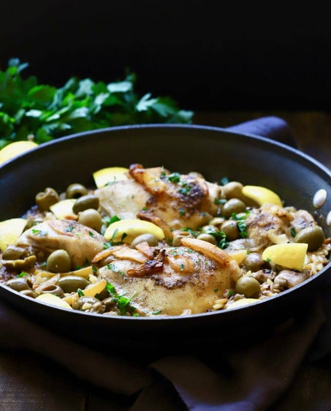 Skillet Chicken with Lemon and Olives served in the skillet it was baked in