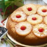 Easy Pineapple Upside Down Cake ready to serve topped with pineapple slices and cherries