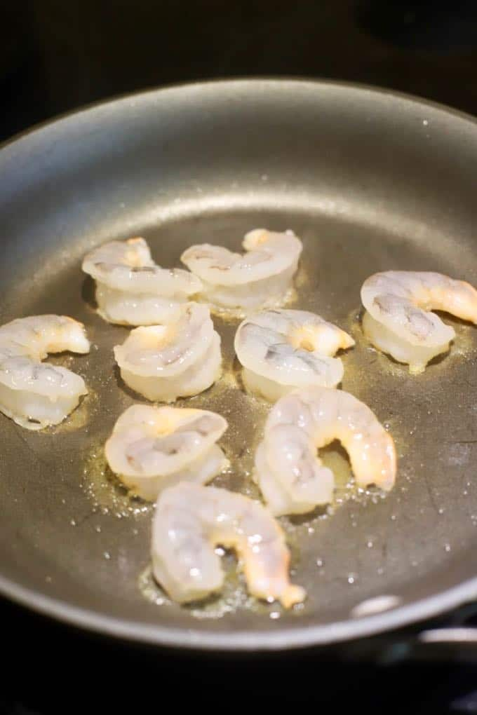 Shrimp sautéing in a skillet for Easy Shrimp and Pineapple Fried Rice