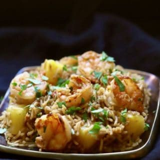 Easy Shrimp and Pineapple Fried Rice on a copper plated garnished with parsley