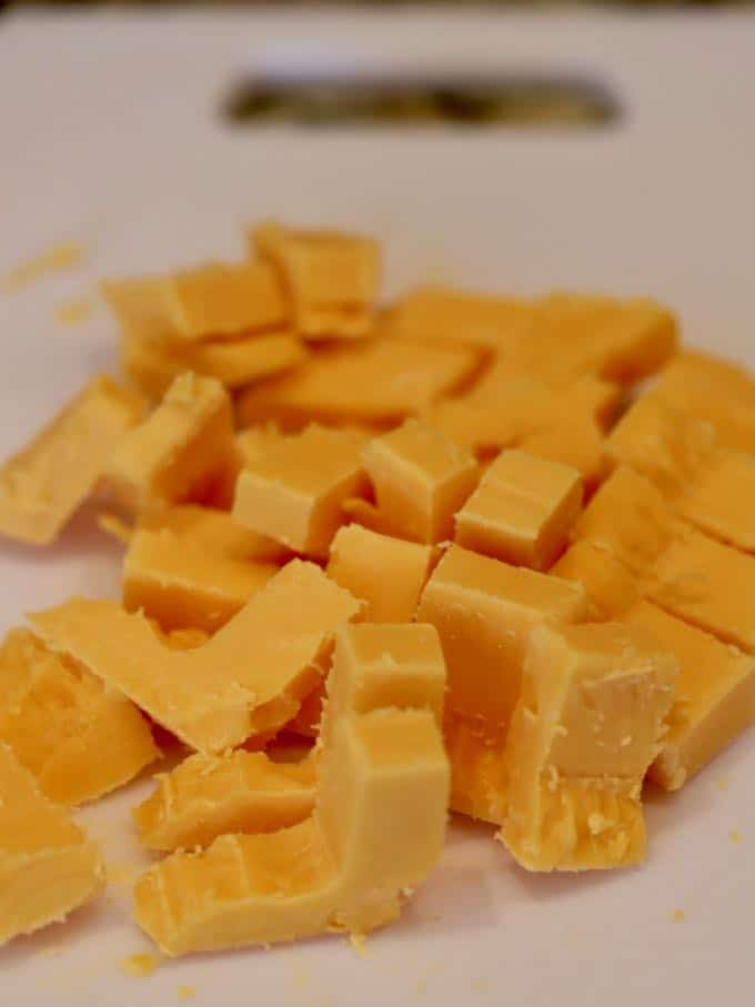 Chunks of cheddar cheese ready to add to the dough for Easy Southern Cheddar Biscuits