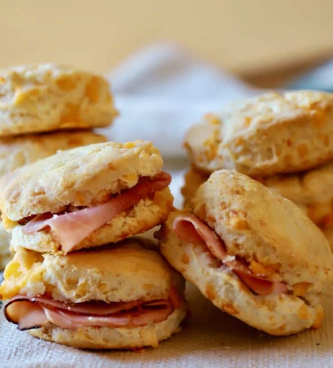 Easy Southern Cheddar Biscuits with a slice of ham in the middle