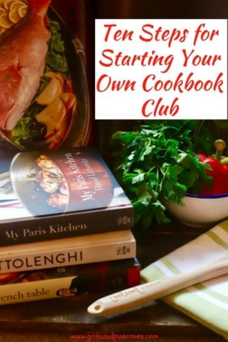 A stack of cookbooks in a photo to promote Ten Steps for Starting Your Own Cookbook Club Pinterest Pin