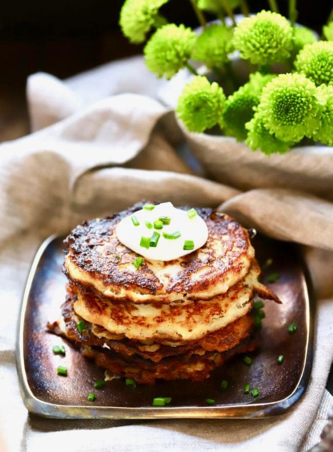 A serving of Traditional Irish Potato Boxty topped with sour cream and chives