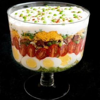 Classic Southern Seven-Layer Salad in a trifle dish