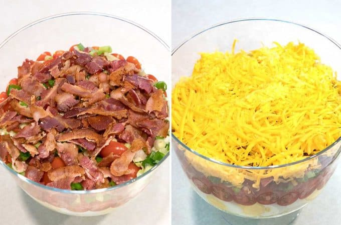 Classic Southern Seven-Layer Salad in a trifle dish showing the fifth layer of bacon and the sixth layer of shredded cheddar cheese.