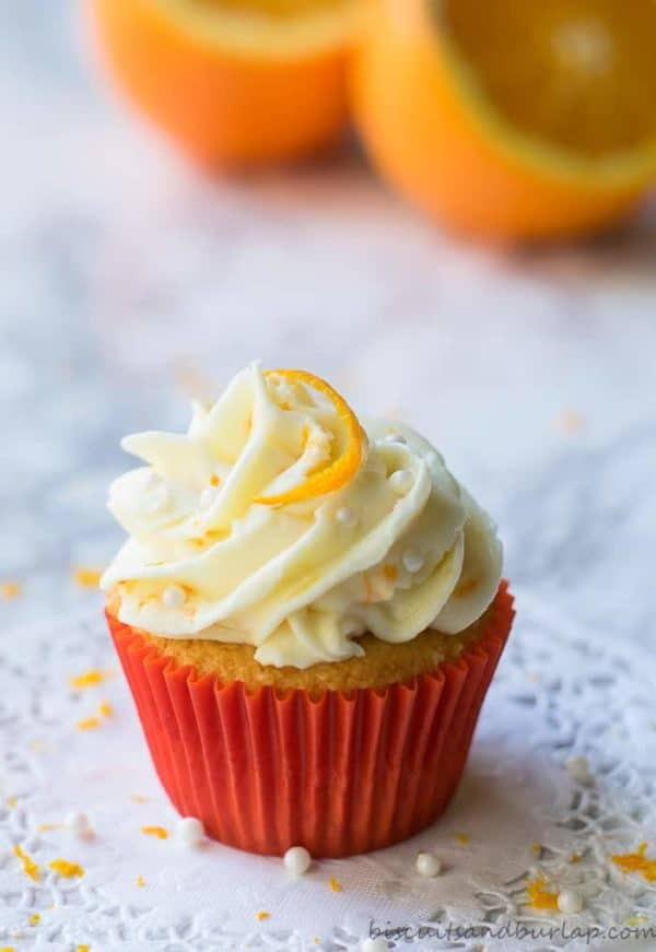 Orange cupcake with orange cream cheese icing and a orange slice on top