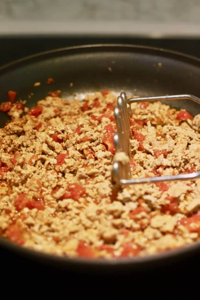 Cooking ground turkey in a skillet for Easy Crunchy Taco Cups