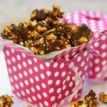 Caramel Corn with Chocolate Drizzle in a pink and white polka dot box