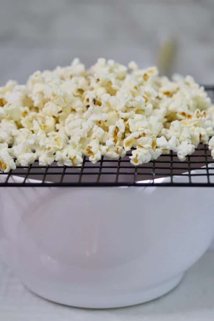 Separating the popcorn from unpopped kernels for Caramel Corn with Dark Chocolate Drizzle