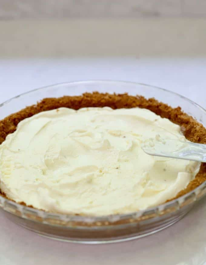 Vanilla ice cream in a cookie crust pie crust for Red White and Blue Ice Cream dessert.