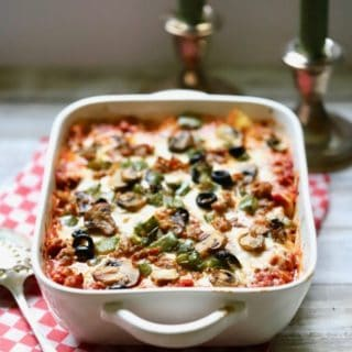 Easy Supreme Pizza Casserole in a white baking dish ready to serve