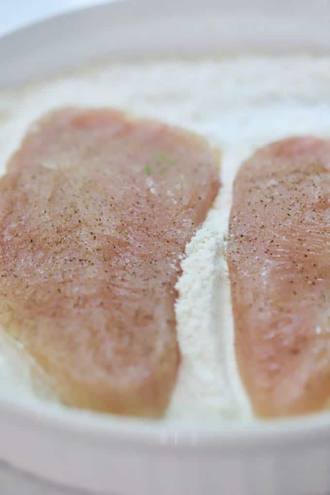 Dredging chicken breasts in flour for Parmesan Chicken with Cucumber Salsa