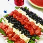 Red, White, and Blue Summer Fruit Salad with watermelon, feta cheese and blueberries ready for the 4th of July