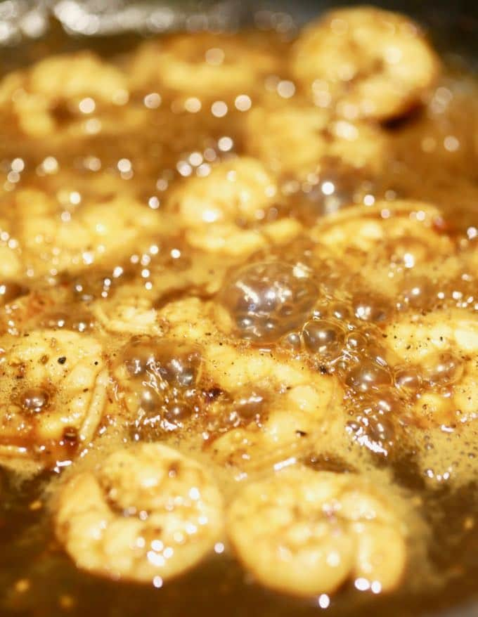 Shrimp cooking in BBQ sauce for Southern BBQ Shrimp and Cheese Grits
