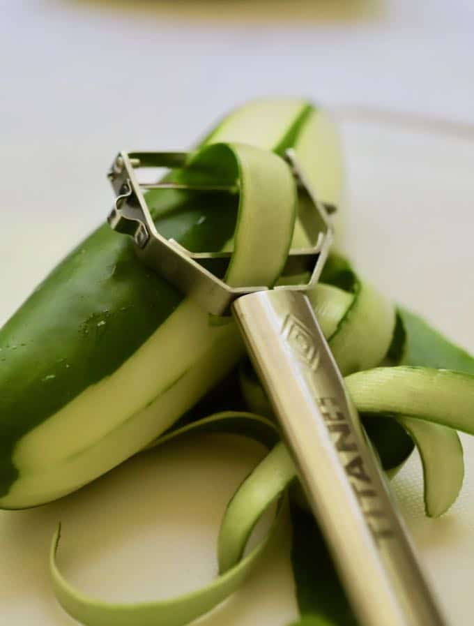 Peeling a cucumber for Chilled Watermelon Gazpacho Soup
