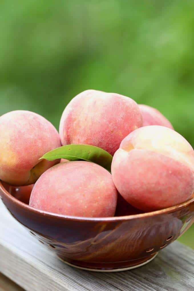 A bowl of fresh peaches ready to make Southern Style Easy Fresh Peach Pie