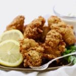 Best Southern Crispy Fried Oysters on a plate with lemon slices