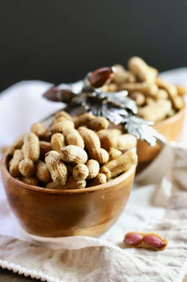 A wooden bowl filled with Easy Southern Boiled Peanuts