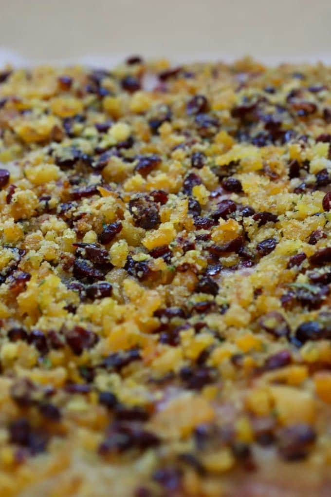 Stuffing covering a butterflied pork loin roast forApricot Cranberry Stuffed Pork Loin Roast