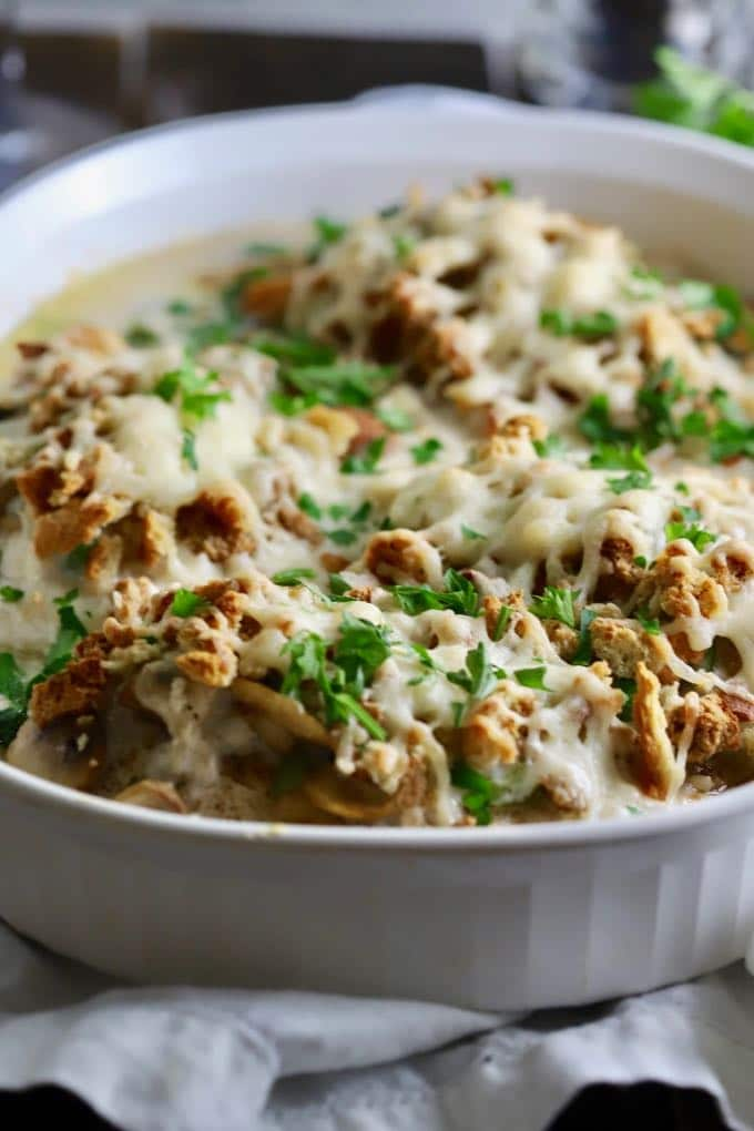 Creamy Oven-Baked Asiago Chicken in a white baking dish ready to serve